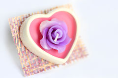 Heart-shaped wax candle with roses Royalty Free Stock Images