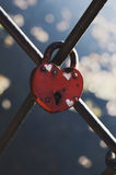 Heart-shaped wedding lock on metal fence Stock Photo