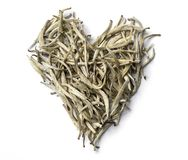 Heart shaped from white tea  on white background. Top view. Close up. High resolution Royalty Free Stock Photography
