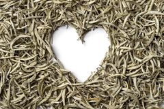 Heart shaped from white tea on white background. Stock Photos