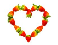 Heart shaped whole strawberry stock images