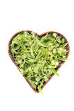 Heart shaped wicker basket with linden tree blossom, isolated Stock Photography