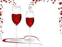 Heart shaped wine glasses filled with love wine. Royalty Free Stock Photography
