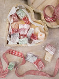 Heart shaped wooden box containing turkish delight with gingham Stock Photo