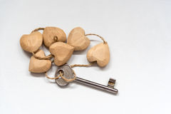 Heart shaped wooden key pendant. With key royalty free stock images