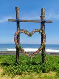 Heart shaped wooden sympathy for wedding, on Bali island beach, Indonesia royalty free stock photography
