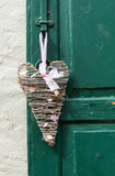 Heart shaped woven decoration on door Royalty Free Stock Photo