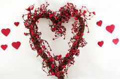 Heart shaped wreath. Grapevine heart shaped wreath with little hearts on it Royalty Free Stock Photos