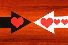 Heart Shapes and the Arrows. Heart Shapes on the Black and White Arrows on the Wooden Background Stock Photography