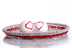 Heart shapes drawn on eggs. Heart shape drawn on eggs and place over beautiful royal vessel , isolated against white background Stock Photo