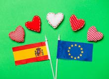 Heart shapes and flag of Europe Union and Spain. Valentines Day heart shapes and flag of Europe Union and Spain on green background Royalty Free Stock Photo