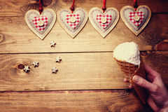 Heart shapes and hand with ice cream Royalty Free Stock Images