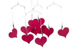 Heart shapes hanging. On white background Stock Images