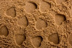 Heart shapes made on the sand background. In view royalty free stock photo