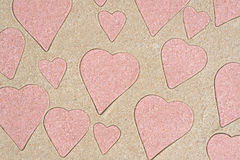 Heart shapes pattern drawing in sand. Background royalty free stock photo