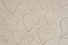 Heart shapes pattern drawing in sand. Background royalty free stock image