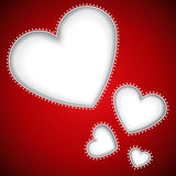 Heart shapes red background Stock Images