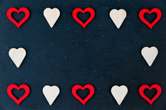 Heart shapes symbols isolated on black, available copy space, love concept Stock Images
