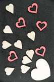 Heart shapes symbols isolated on black, vintage filter applied, available copy space, love concept Royalty Free Stock Images