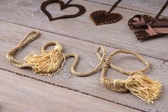 Heart shapes and word love made from rope Royalty Free Stock Photo