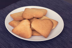 Heart-shapped cookies on a plate. A selection of heart-shapped homemade biscuits on a plate Stock Image