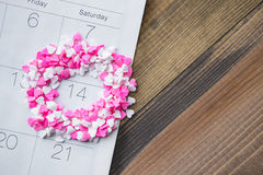 Heart Shave Sprinkles Round Valentine Date on Calendar with Wood Royalty Free Stock Photo