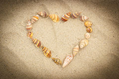 Heart of shells on sand at the beach, symbol of love Royalty Free Stock Photo