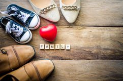 Heart shoes for family. For the love of a family whose parents show warmth and care Stock Images