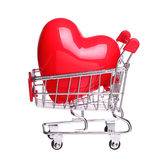 Heart in shopping cart concept isolated on white background Royalty Free Stock Photos