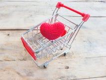 Heart in shopping cart Stock Photos