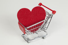 Heart and shopping cart Stock Image