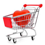 Heart in a shopping cart. A red heart in a shopping cart on a white background Royalty Free Stock Photography