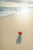 Heart on the shore 1. A portrait crop of a cut out red heart with shadow on the seashore Stock Image