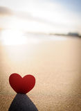 Heart on the shore 4. A portrait crop of a cut out red heart with shadow on the seashore Royalty Free Stock Photos