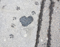 Heart on sidewalk - wet spot on the sidewalk Royalty Free Stock Images