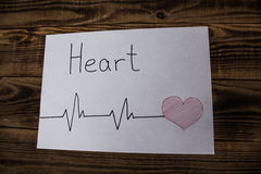 Heart sign with cardiogram stock photo