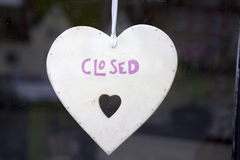 Heart with sign closed in window shop Stock Image