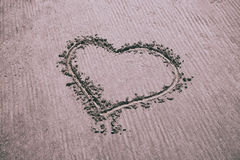 Heart sign drawn by hand on sandy beach Royalty Free Stock Photo