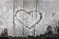 Heart sign on frozen wood Stock Photos