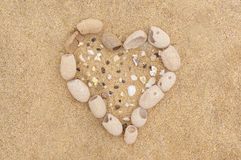 Heart sign on the sand Stock Photos
