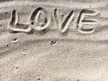 Heart sign on a sand made of stones. Or handy royalty free stock image
