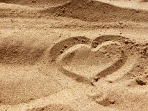 Heart sign on a sand made of stones. Or handy stock photos