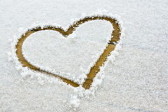 Heart signed in fresh snowflakes Stock Photos