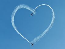 Heart into the sky. Two airplanes drawing heart into the sky Royalty Free Stock Photography