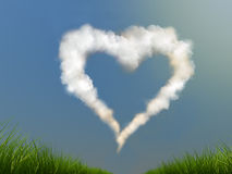 Heart on the sky. Cloud heart on the blue sky the green grass on ground stock photo