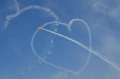 Heart on sky. Airplane drawing a heart on the sky Royalty Free Stock Photography