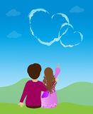 Heart in the sky. Young couple in love looking at a heart shaped cloud royalty free illustration