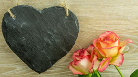A heart of slate with roses Stock Photography