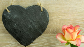 A heart of slate with roses Royalty Free Stock Image