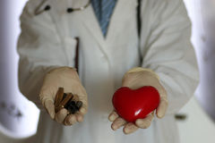 Heart and sleeve in doctor hand Stock Image